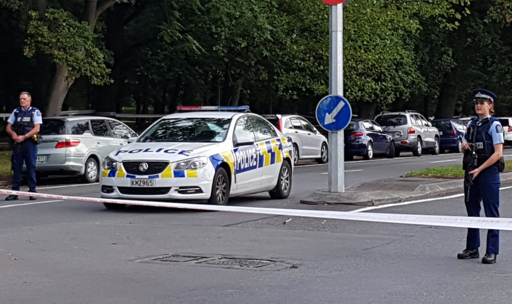 Police officers cordon off the area close to the mosque after a gunman filming himself firing at worshippers inside in Christchurch on March 15, 2019. - A gunman opened fire inside the Masjid al Noor mosque during afternoon prayers, causing multiple fatalities. (Photo by Flynn FOLEY / AFP) (Photo credit should read FLYNN FOLEY/AFP/Getty Images)