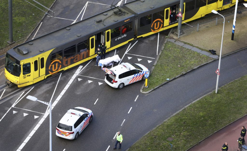 Dutch police inspect a tram at the 24 Oktoberplace in Utrecht of the Netherlands where a shooting took place. Photo by Ric...