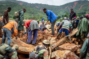 Members of the public and military personnel search for survivors and bodies in Ngangu township Chimanimani, Manicaland Province, eastern Zimbabwe, on March 18 2019, after the area was hit by the cyclone Idai. Photo by Zinyange Auntony/AFP/Getty Images