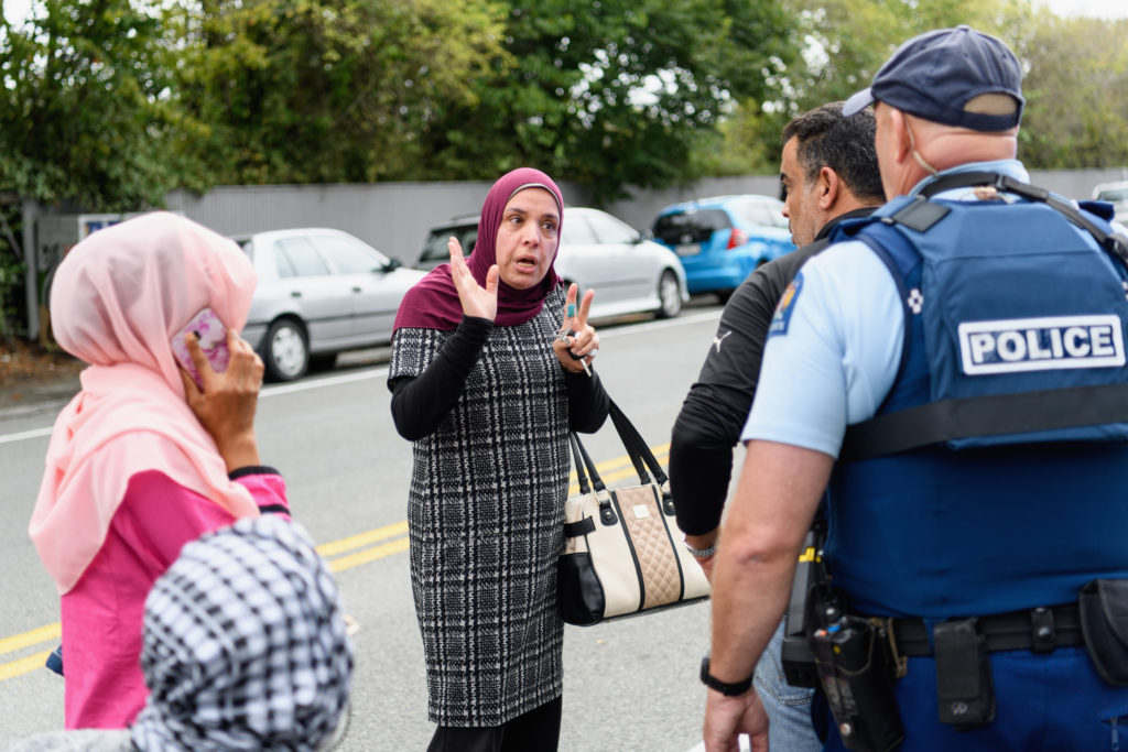 Members of the public react in front of the Masjd Al Noor Mosque as they fear for their relatives in Christchurch, New Zealand. Photo by Kai Schwoerer/Getty Images