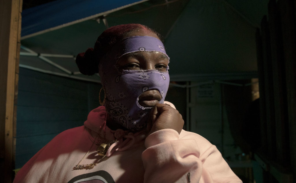 Leikeli47 poses for a photo after one of the masked rapper's performances at SXSW this year. Photos by Joshua Barajas/PBS NewsHour
