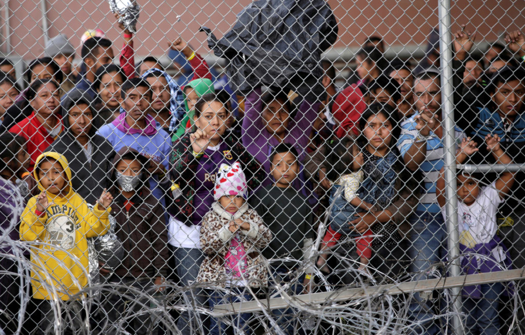 Central American migrants are seen inside an enclosure where they are being held by U.S. Customs and Border Protection (CB...