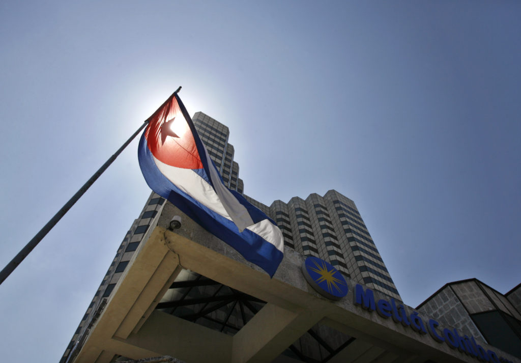The Cuban flag stands outside a hotel of the Spanish Melia hotel chain in Havana March 17, 2008. Major investors in Cuba i...
