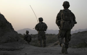 FILE PHOTO: U.S. Army soldiers walk back to their base after a patrol in Arghandab Valley, north of Kandahar on April 12, 2011. Four American soldiers have been killed in Afghanistan this year. Photo by Bob Strong/Reuters