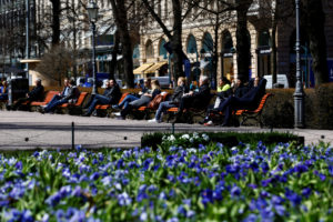 People enjoy a sunnny day at the Esplanade in Helsinki, Finland, which earned the highest ranking in the World Happiness Report for the second year in a row. Photo by Ints Kalnins/Reuters