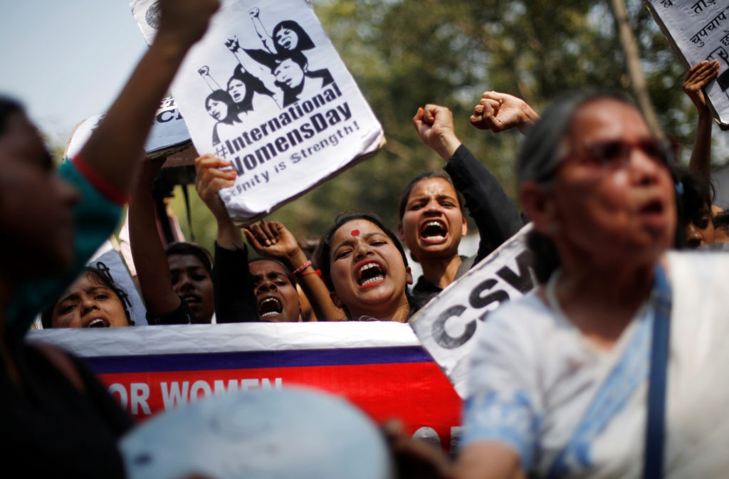 Girls shout slogans during a protest demanding equal rights for women on the occasion of International Women's Day in New Delhi, India. Photo by Adnan Abidi/Reuters