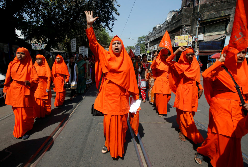 Hindu nuns shout slogans during a rally to mark the International Women's Day in Kolkata, India. Photo by Rupak De Chowdhuri/Reuters