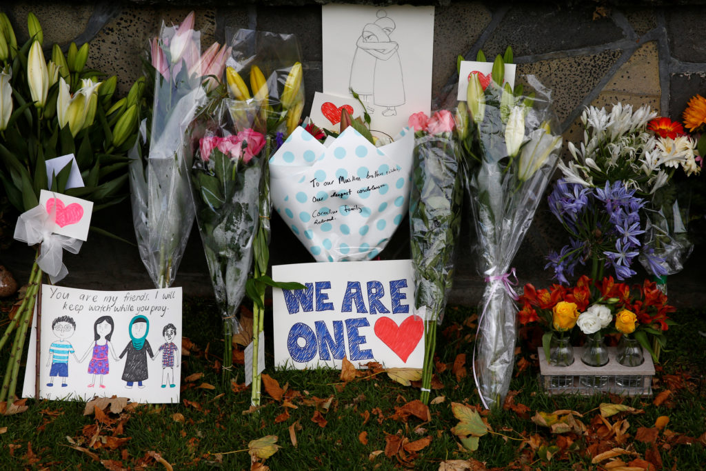Flowers and signs are seen at a memorial as tributes to victims of the mosque attacks near Linwood mosque in Christchurch, New Zealand, March 16, 2019. Photo by Edgar Su/Reuters