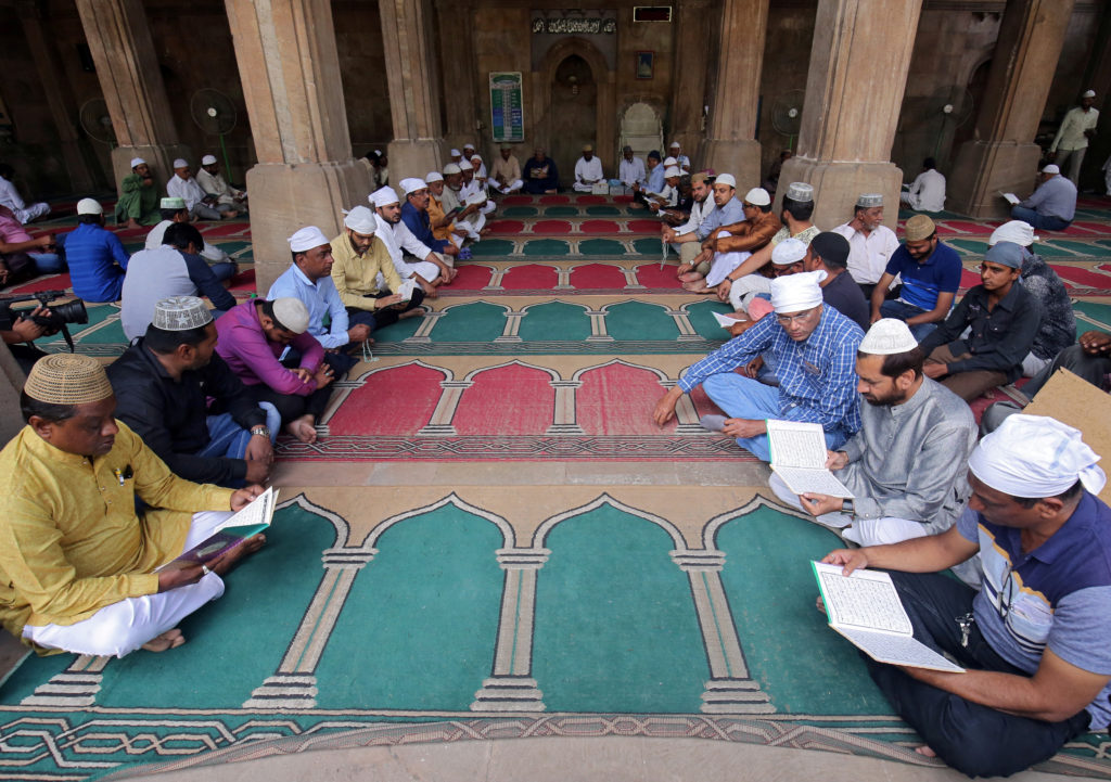 Muslims read the Koran during a prayer meet for victims of Friday's mosque attacks in New Zealand, inside a mosque in Ahmedabad, India, March 16, 2019. Photo by Amit Dave/Reuters