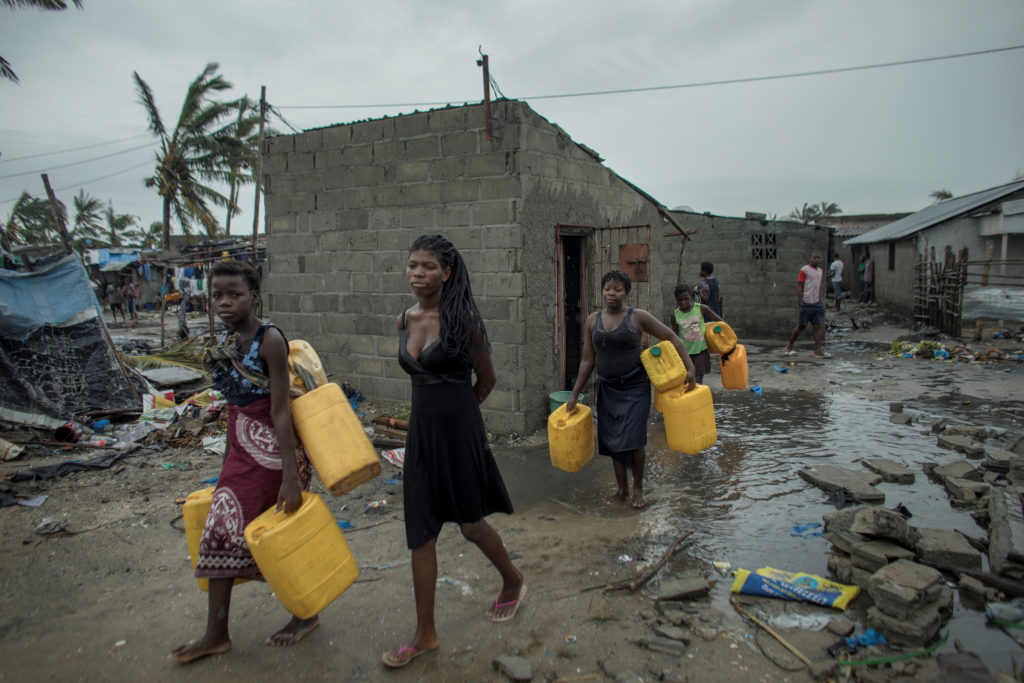 People return to Praia Nova Village neighborhood following Cyclone Idai in Beira, Mozambique, March 17, 2019. Josh Estey/Care International via Reuters