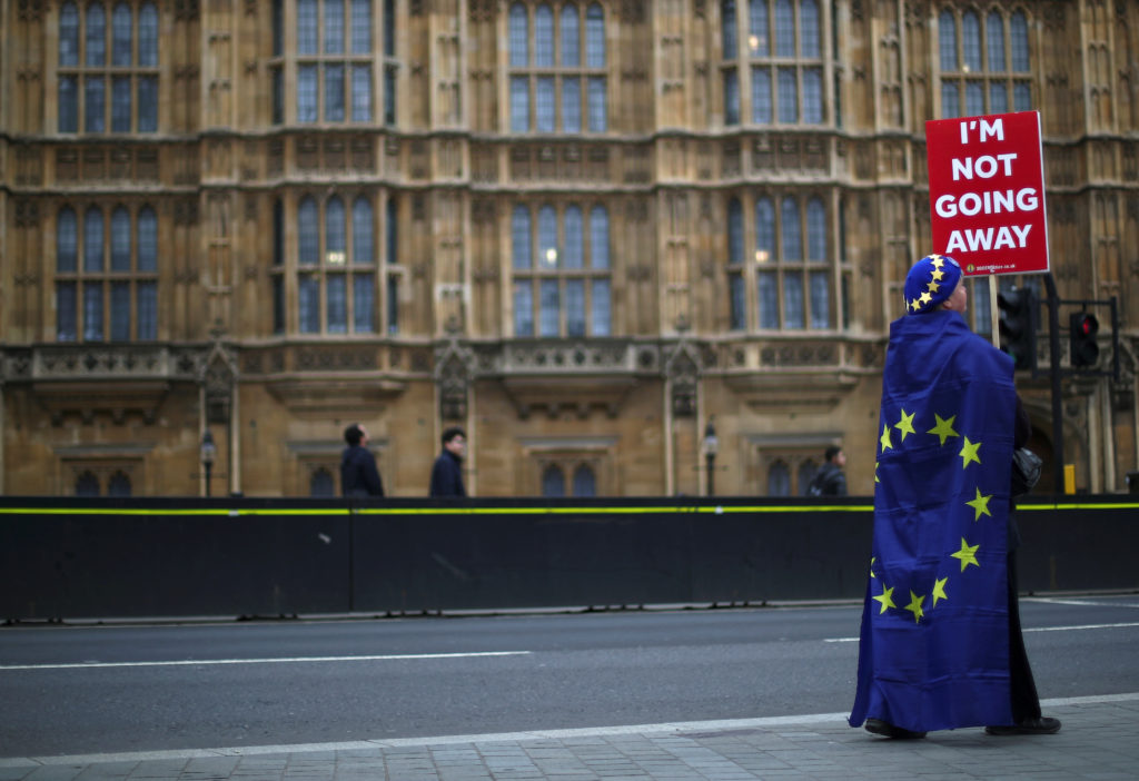 An anti-Brexit protester is seen outside the Houses of Parliament in London on March 20, 2019. Photo by Hannah McKay/Reuters