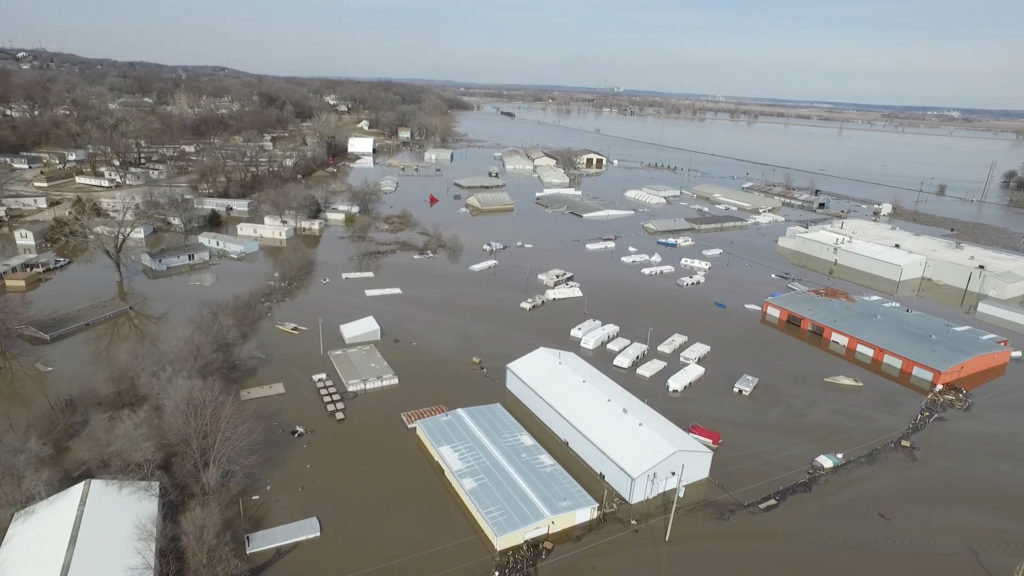 Flooded areas are seen in Bellevue, Nebraska on March 19, 2019 in this still image taken from a video obtained from social media on March 20, 2019. Photo by Bellevue Police Department via Reuters
