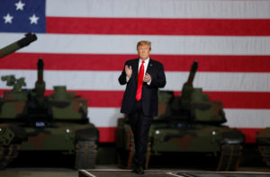 President Donald Trump applauds as he takes the stage while touring the Lima Army Tank Plant (LATP) Joint Systems Manufacturing Center, the country's only remaining tank manufacturing plant, in Lima, Ohio, on March 20, 2019. Photo by Carlos Barria/Reuters