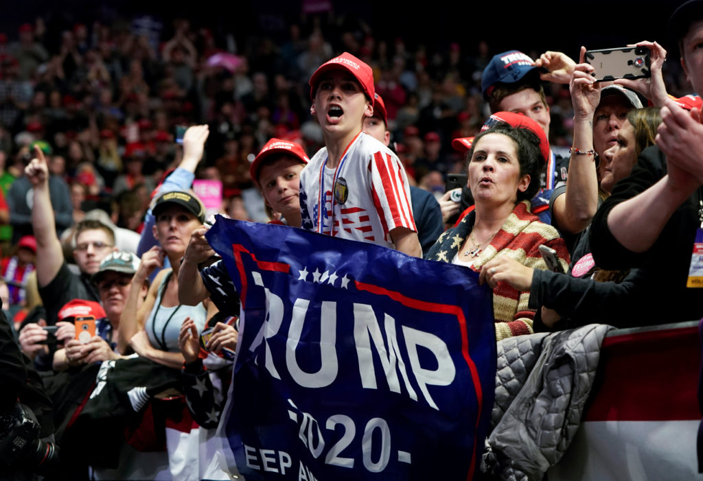 U.S. President Donald Trump is cheered by supporters as he arrives …