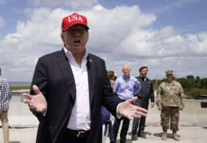 President Donald Trump speaks to reporters as U.S. Senator Rick Scott, Florida Governor Ron Desantis and others look on during the president's visit to Lake Okechobee and the Herbert Hoover Dike in Canal Point, Florida, on March 29, 2019. Photo by Joshua Roberts/Reuters
