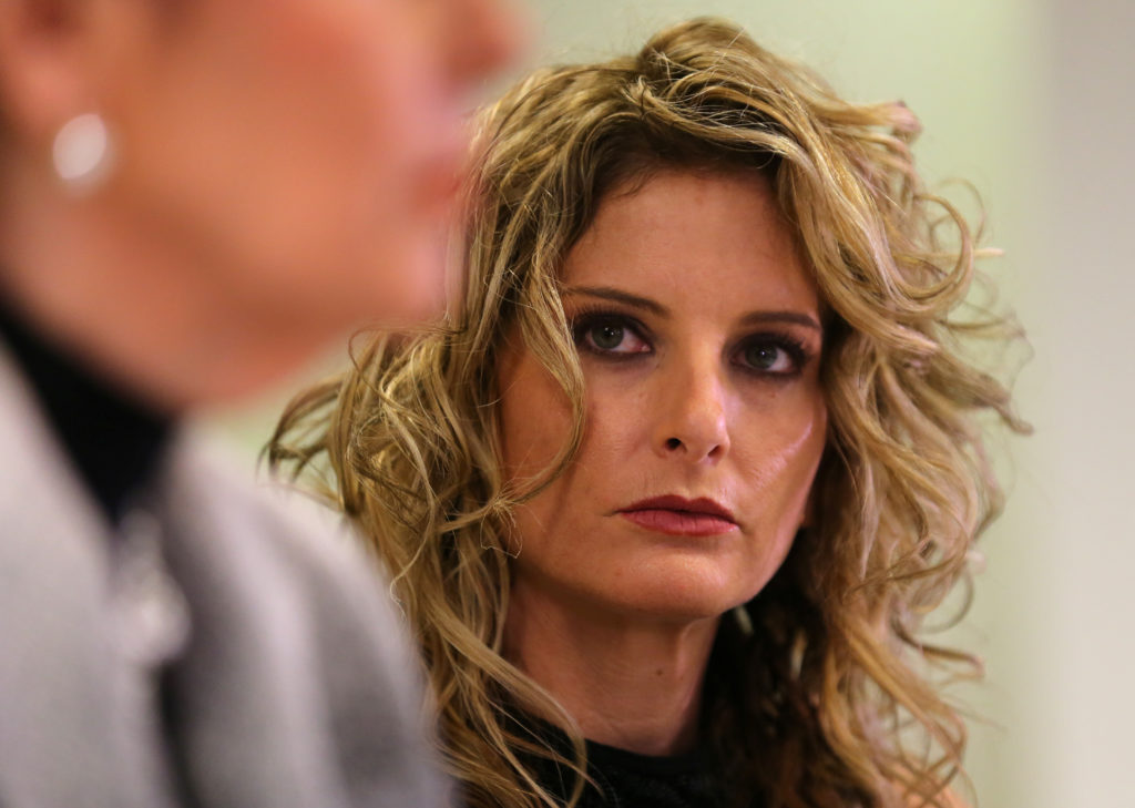 Summer Zervos listens as her attorney Gloria Allred speaks during a…