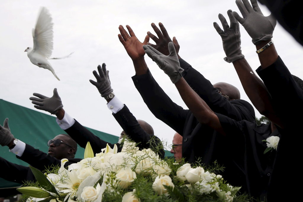 Pall bearers release white doves over the casket of mass shooting victim Ethel Lance as she is buried at the Emanuel African Methodist Episcopal Church cemetery in North Charleston, South Carolina in a June 25, 2015 file photo. While it's not yet clear what effect the church shooting in Charleston will have on gun purchases, a growing number of African-Americans across the United States have changed their position on firearms in recent years, breaking with a long tradition of gun control advocacy among  blacks and embracing the kind of pro-gun positions that have long been more widely held by whites. Photo by Brian Snyder/Reuters