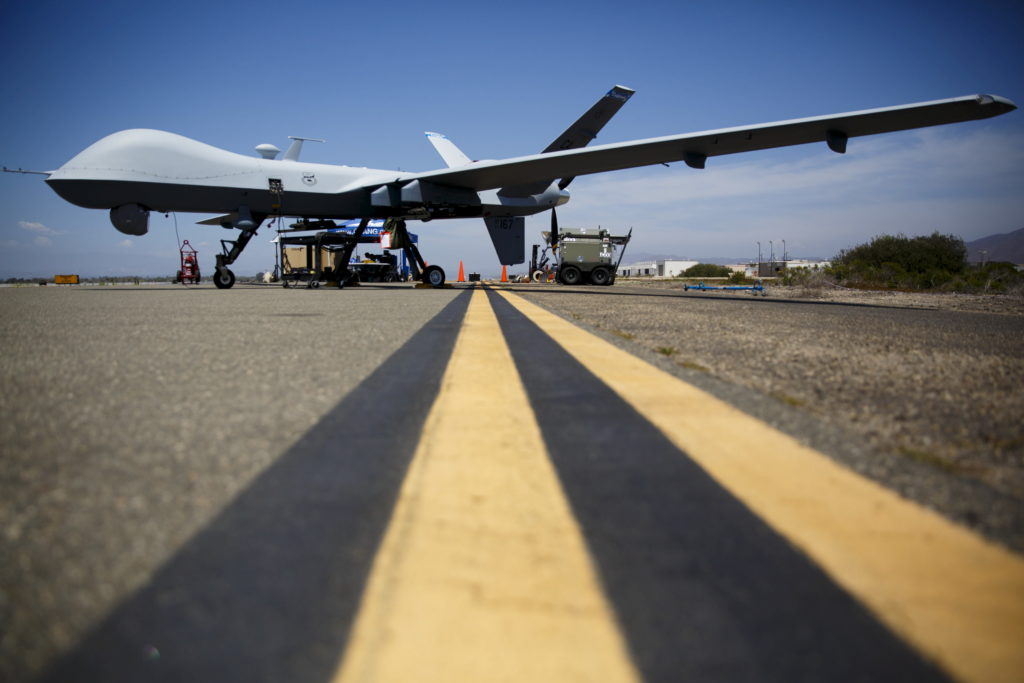 """A General Atomics MQ-9 Reaper stands on the runway during """"Black Dart"""", a live-fly, live fire demonstration of 55 unmanned aerial vehicles, or drones, at Naval Base Ventura County Sea Range, Point Mugu, near Oxnard, California July 31, 2015. REUTERS/Patrick T. Fallon"""