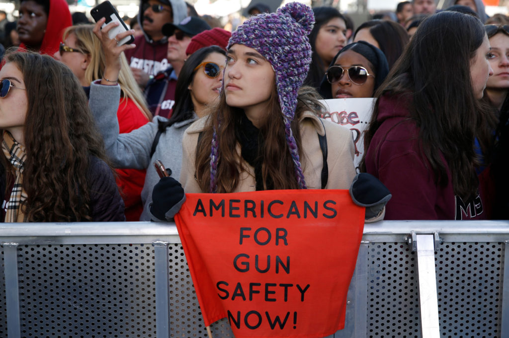 "Isabel White, an 8th grader who will go to Marjory Stoneman Douglas High School in Parkland, Florida next year, displays a banner as students and gun control advocates hold the ""March for Our Lives"" event demanding gun control after recent school shootings at a rally in Washington on March 24, 2018. Photo by Jonathan Ernst/Reuters"
