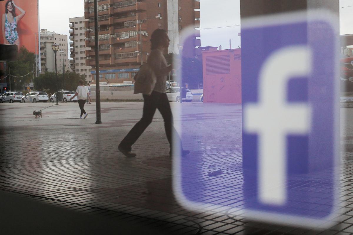 Facebook logo is seen on a shop window in Malaga, Spain on June 4, 2018. Photo by Jon Nazca/Reuters