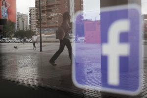 Facebook logo is seen on a shop window in Malaga, Spain on June 4, …