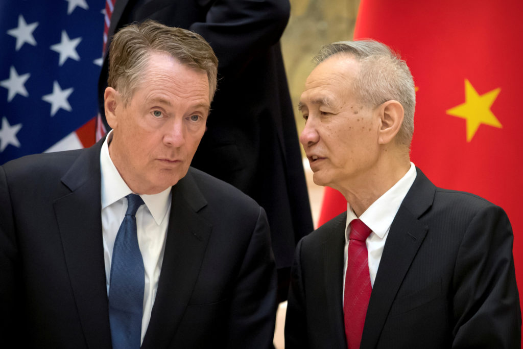 U.S. Trade Representative Robert Lighthizer, left, listens as Chinese Vice Premier Liu He talks while they line up for a group photo at the Diaoyutai State Guesthouse in Beijing on February 15, 2019. Photo by Mark Schiefelbein/Pool via Reuters