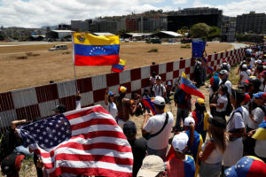 Supporters of the Venezuelan opposition leader Juan Guaido, who many nations have recognized as the country's rightful interim ruler, take part in a rally to demand President Nicolas Maduro to allow humanitarian aid to enter the country, outside of an Air Force base in Caracas, Venezuela on February 23, 2019. Photo by Carlos Garcia Rawlins/Reuters