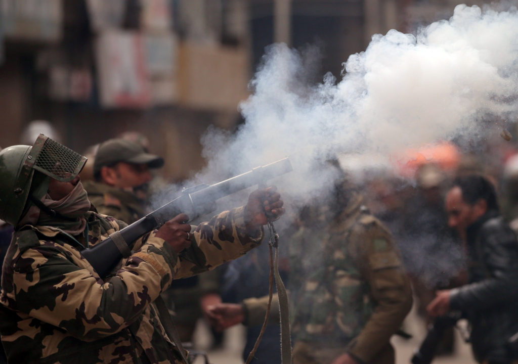 A member of Indian Central Reserve Police Force (CRPF) fires a tear gas shell during a protest by Kashmiri demonstrators after India's National Investigation Agency (NIA) members carried out a raid at the residence of Yasin Malik, Chairman of Jammu Kashmir Liberation Front (JKLF), a separatist party, in Srinagar February 26, 2019. Danish Ismail/Reuters