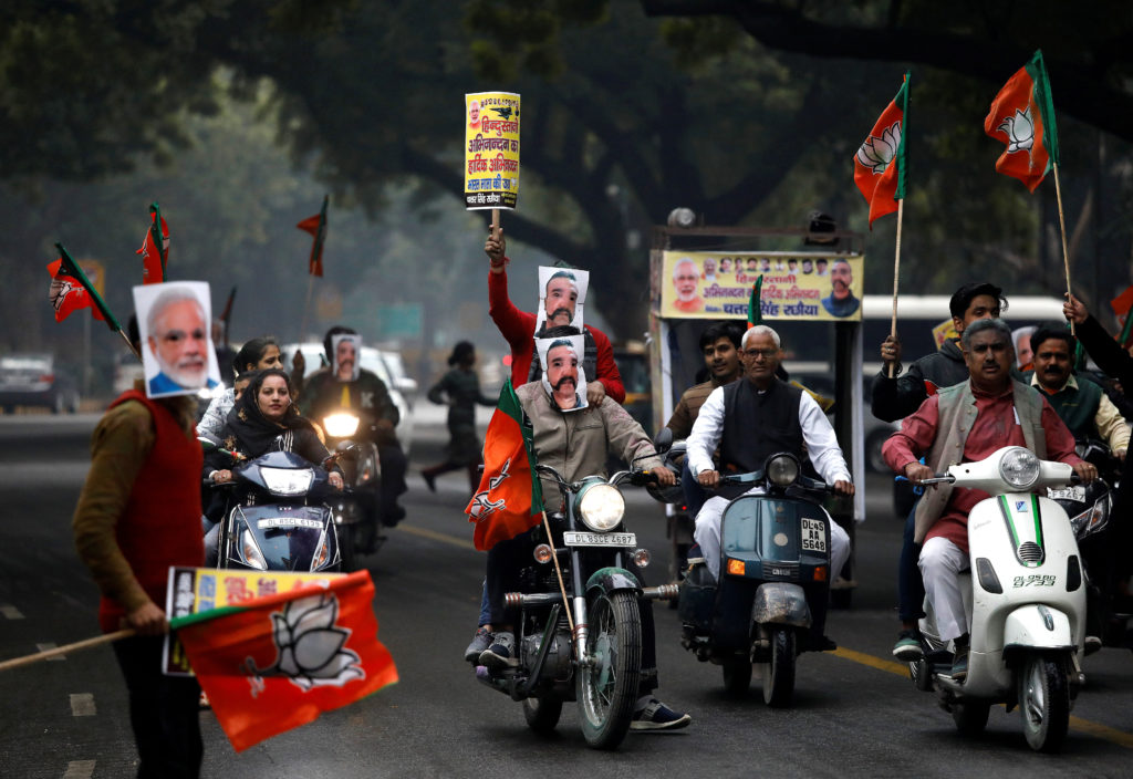 Supporters of India's ruling Bharatiya Janata Party (BJP) wearing masks of Indian Air Force pilot Wing Commander Abhinandan Varthaman and Prime Minister Narendra Modi ride their motorbikes during a rally to celebrate after Abhinandan was released by Pakistan, in New Delhi, India, March 2, 2019. Photo by Anushree Fadnavis/Reuters