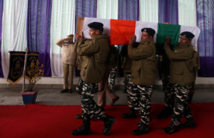 India's Central Reserve Police Force (CRPF) personnel carry the coffin of their colleague, who according to police was killed during a gun battle with militants in north Kashmir's Kupwara district on Friday, during a wreath-laying ceremony on the outskirts of Srinagar March 2, 2019. Photo by Danish Ismail/Reuters