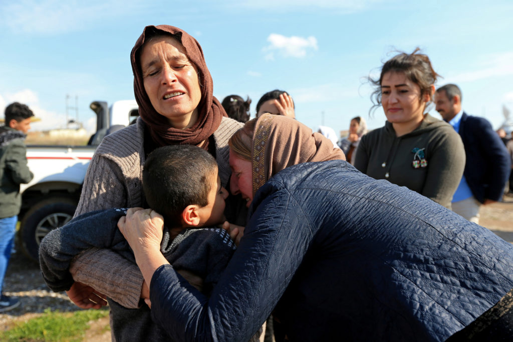 Relatives hug a Yazidi survivor boy following his release from Islamic State militants in Syria, in Duhok, Iraq, March 2, 2019. Photo by Reuters/Ari Jalal