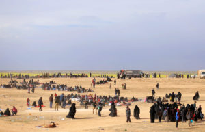A general view of people walking near Baghouz, Deir Al Zor province, Syria March 5, 2019. Photo by Rodi Said/Reuters