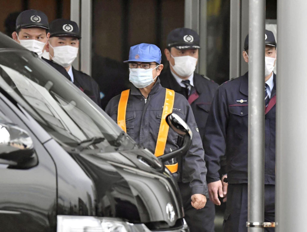 A person believed to be former Nissan Motor Chairman Carlos Ghosn (wearing blue cap) leaves the Tokyo Detention House on March 6, 2019. Photo by Kyodo/via Reuters
