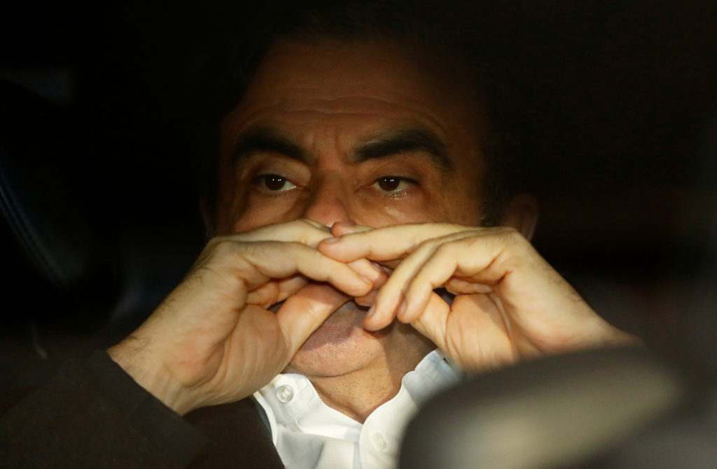Former Nissan Motor Chairman Carlos Ghosn sits inside the car as he leaves his lawyer's office after being released on bail from Tokyo Detention House in Japan on March 6, 2019. Photo by Issei Kato/Reuters