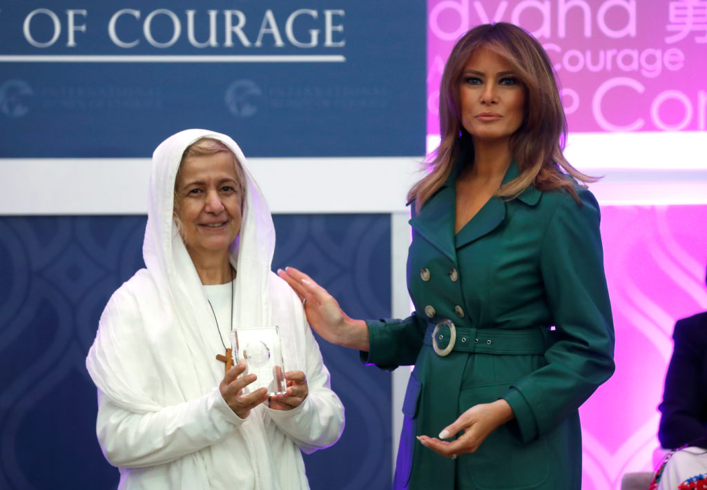 First lady Melania Trump presents an award to Mama Maggie of Egypt during the International Women of Courage (IWOC) celebration at the State Department in Washington. Photo by Kevin Lamarque/Reuters