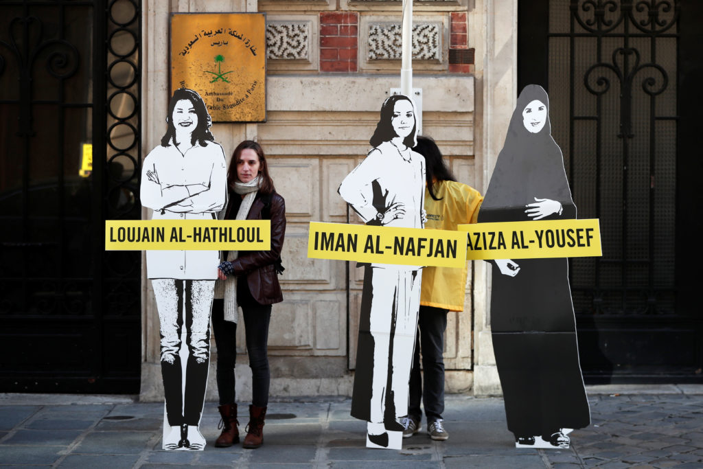 Demonstrators from Amnesty International stage the protest on International Women's day to urge Saudi authorities to release jailed women's rights activists Loujain al-Hathloul, Eman al-Nafjan and Aziza al-Yousef outside the Saudi Arabian Embassy in Paris, France. Photo by Benoit Tessier/Reuters