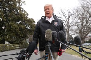 President Donald Trump talks to reporters as he departs to visit storm-hit areas of Alabama from the White House. Photo by Jonathan Ernst/Reuters