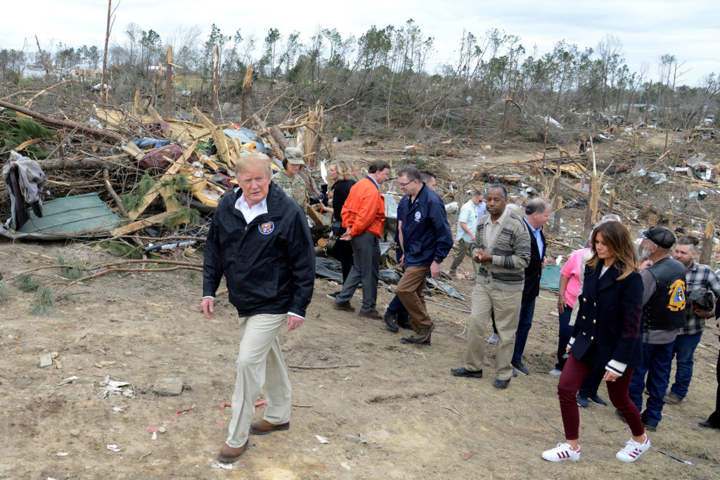 President Donald Trump and First Lady Melania Trump survey tornado damage in Beauregard, Alabama. Photo by Mike Theiler/Re...