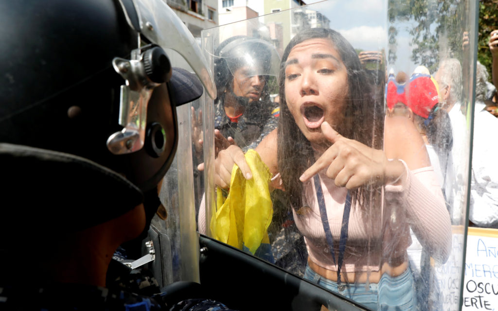 Venezuela opposition protesters scuffle with police as blackout lingers class=