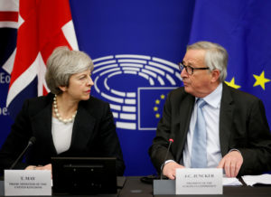 British Prime Minister Theresa May and European Commission President Jean-Claude Juncker look at each other during a news conference in Strasbourg, France on March 11, 2019. Photo by Vincent Kessler/Reuters/File Photo
