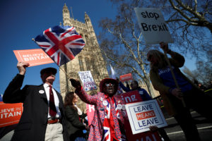 Pro-Brexit and anti-Brexit protesters stand outside of the Houses of Parliament in London, onFebruary 27, 2019. Photo by Hannah Mckay/Reuters