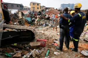 Rescuers are seen as people search for belongings at the site of a collapsed building in Nigeria's commercial capital of Lagos, Nigeria on March 14, 2019. Photo by Afolabi Sotunde/Reuters