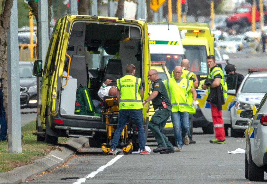 An injured person is loaded into an ambulance following a shooting …