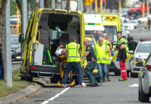An injured person is loaded into an ambulance following a shooting at the Al Noor mosque in Christchurch, New Zealand. Photo by Martin Hunter/SNPA/Reuters