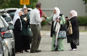 Members of a family react outside the mosque following a shooting at the Al Noor mosque in Christchurch, New Zealand. Photo by Martin Hunter/SNPA/Reuters