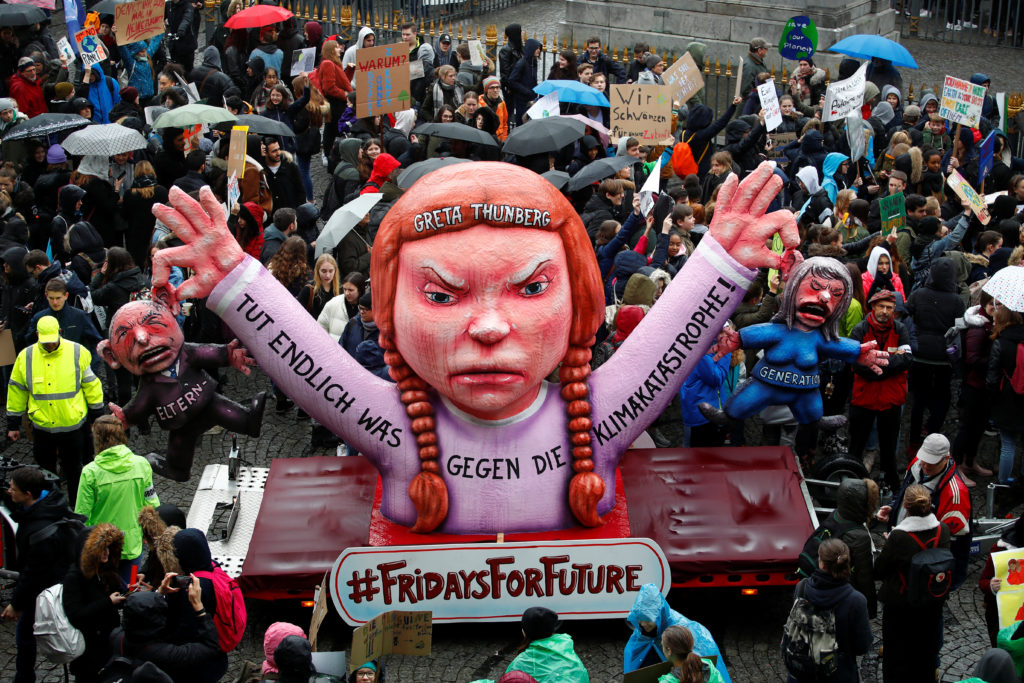 Students use a carnival float depicting Swedish environmental campaigner Greta Thunberg during a strike from school to demand action on climate change at the town hall square of Duesseldorf, Germany.  Wolfgang Rattay/Reuters