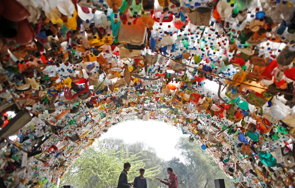 Students perform under a shade made from used plastic bottles as they take part in a global protest against climate change in Gurugram, India. Photo by Adnan Abidi/Reuters
