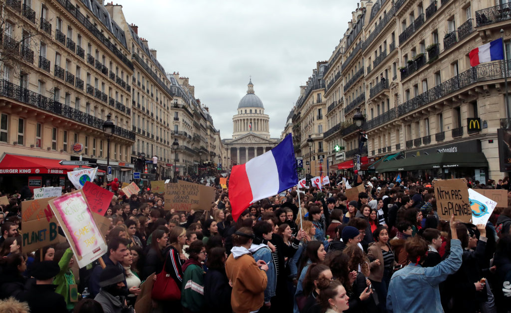 """Students take part in a """"youth strike to act on climate change"""" demonstration in Paris. Gonzalo Fuentes/Reuters"""