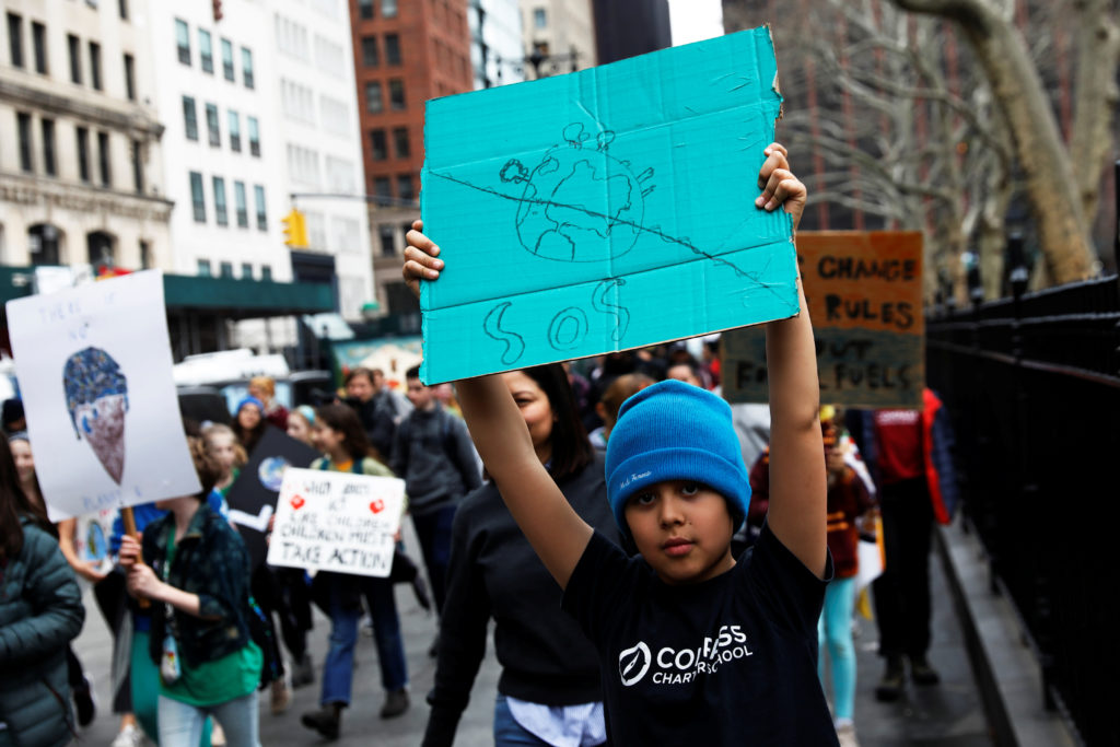Students hold banners and placards during a demonstration against climate change in New York. Shannon Stapleton/Reuters