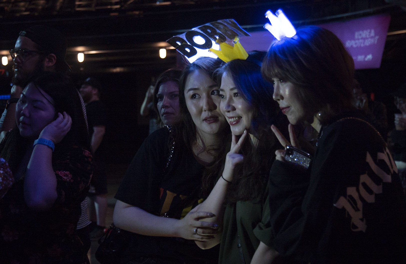 "Fans pose for a picture shortly before the ""Korean Spotlight"" showcase. Photo by Joshua Barajas/PBS NewsHour"